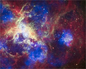 This composite of 30 Doradus, aka the Tarantula Nebula, contains data from Chandra (blue), Hubble (green), and Spitzer (red). Located in the Large Magellanic Cloud, the Tarantula Nebula is one of the largest star-forming regions close to the Milky Way. Chandra's X-rays detect gas that has been heated to millions of degrees by stellar winds and supernovas. This high-energy stellar activity creates shock fronts, which are similar to sonic booms. Hubble reveals the light from massive stars at various stages of star birth, while Spitzer shows where the relatively cooler gas and dust lie.